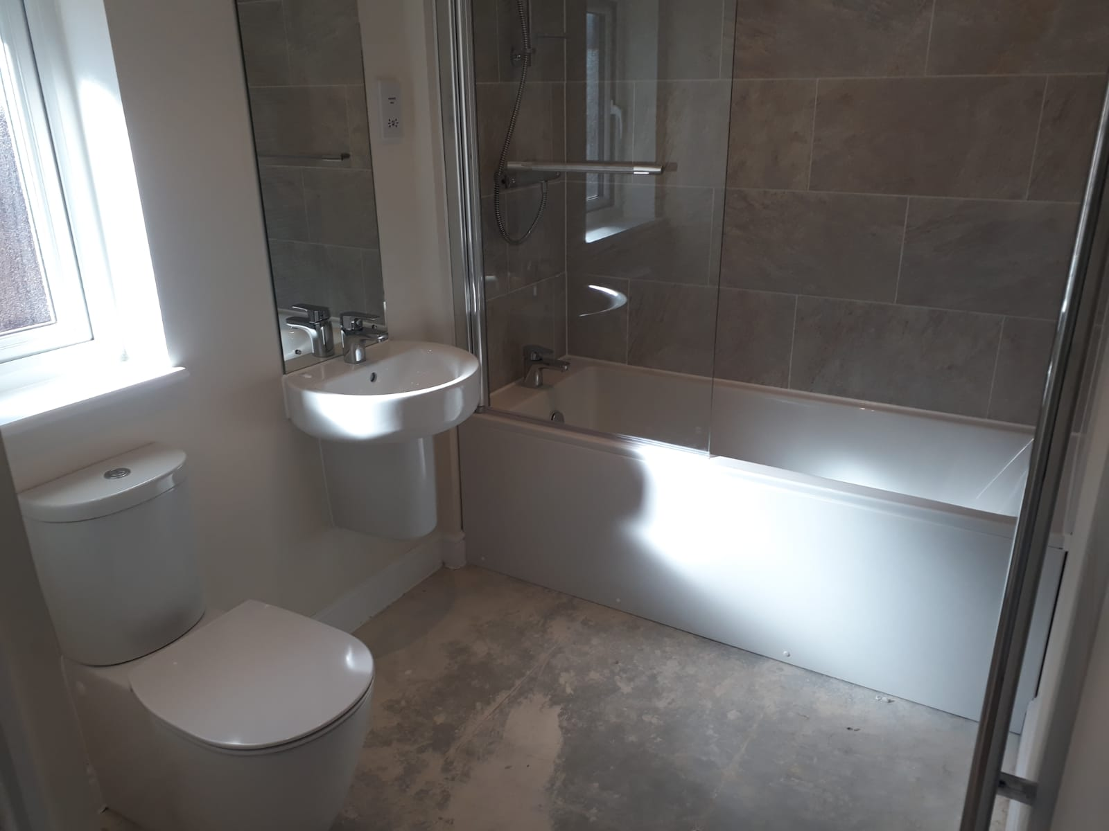 New bathroom with toilet and shower